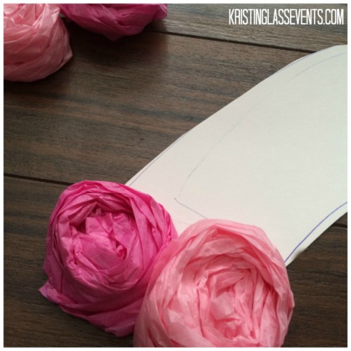 I've made these awesome DIY tissue paper rose symbols for a couple events now. They are so easy and the materials are totally affordable - they just take a little time to put together (and a love for hot glue)! Here's a simple how-to article.